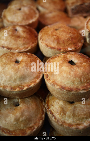 pie pies pasty meat vegetable traditional English United Kingdom snack meal dinner winter warm warming comfort food - Stock Image