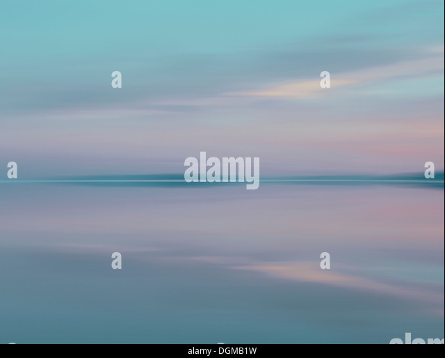 Shallow water over the surface at the Bonneville Salt Flats at dusk. - Stock Image