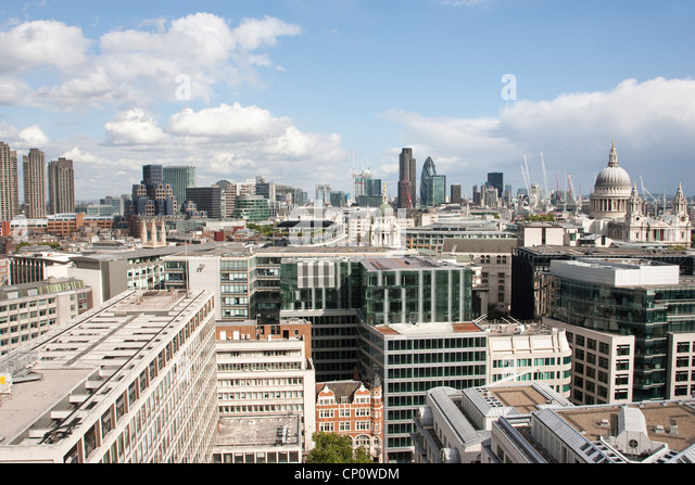 Wide-angle Cityscape across the skyline of the City of London, showing the financial district in the distance, England, - Stock Image