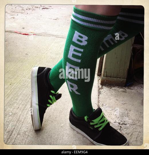 Funny green beer socks - Stock Image