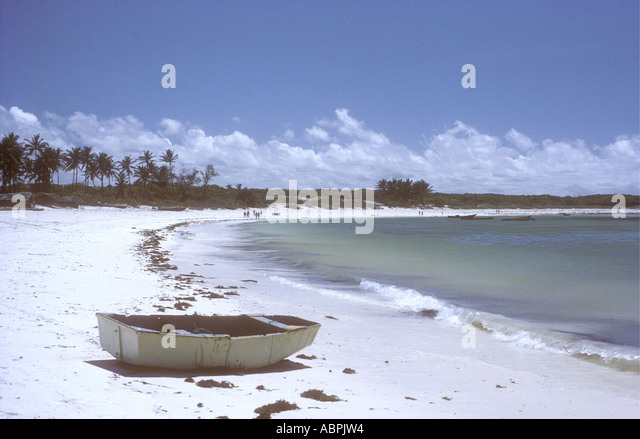 A small rowing boat on the beach at Turtle Bay Watamu Kenya coast East Africa - Stock Image