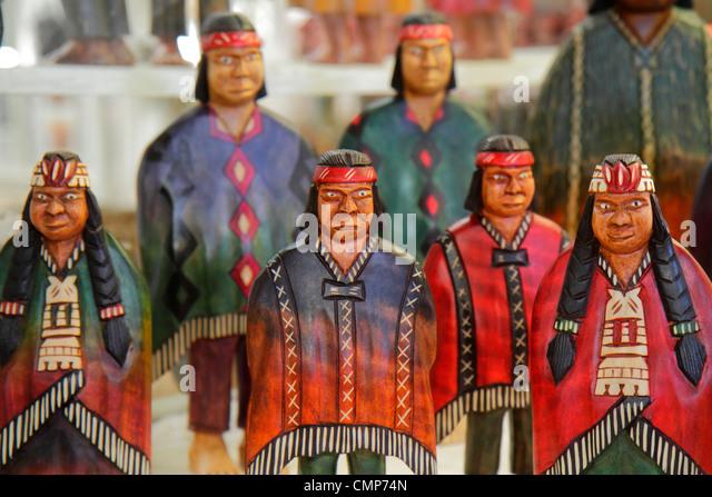 Chile Santiago Las Condes Plaza los Dominicos shopping souvenir gift shop decor handicrafts wood carving indigenous - Stock Image