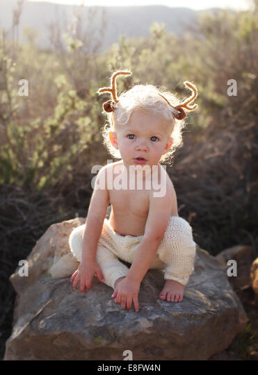 Toddler with antlers on his head - Stock-Bilder