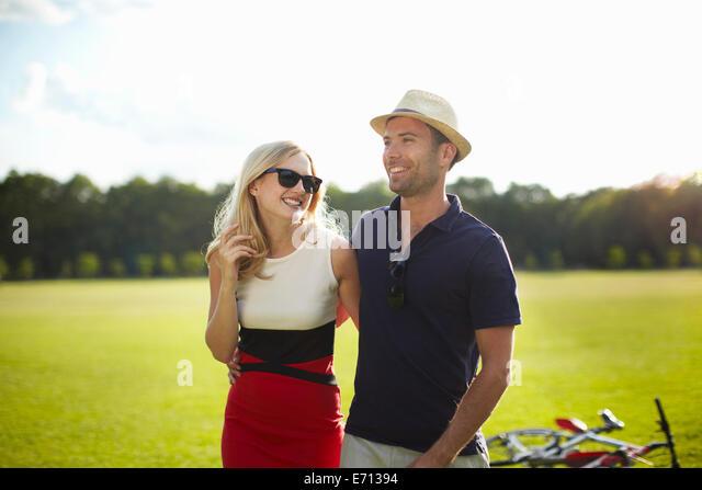 Couple strolling in park - Stock-Bilder