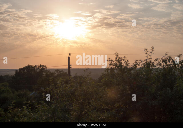 Dawn in the mountains of Abkhazia against the background of the cloudy sky - Stock Image