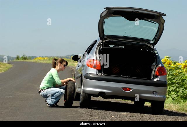 Flat tire woman changing stock photos amp flat tire woman changing stock