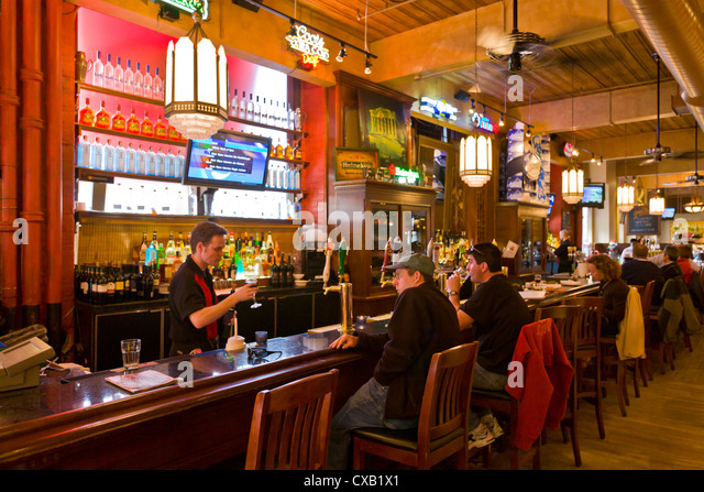 Patrons enjoying a drink at a pub, Toronto, Ontario, Canada, North America - Stock Image