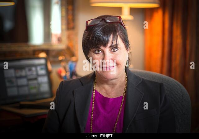 Portrait of senior woman in office - Stock Image