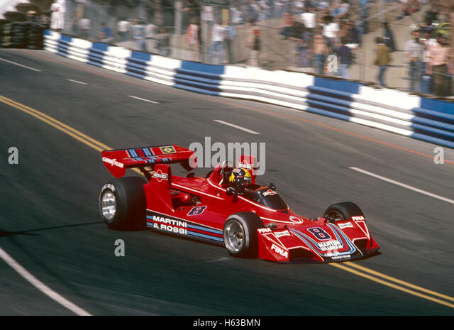 Carlos Pace driving his Brabham BT44 Alfa Romeo racing car 1975 Long Beach US GP West - Stock Image