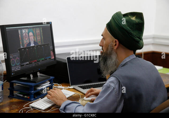 Naqshbandi sufi muslim editing footage in the Lefke dergah, Cyprus. - Stock Image