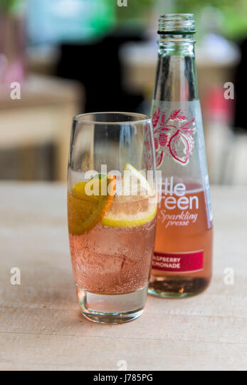 A bottle of Bottle Green Soft drink; Sparkling presse; Rasberry and lemonade; Sparkling water drink; Refreshing; - Stock Image