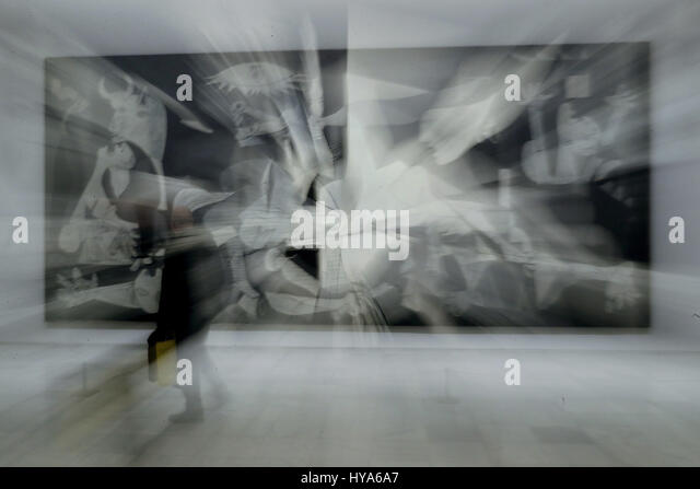 A visitor observes the work of art 'Guernica', by Spanish artist, Pablo Picasso, during the presentation - Stock Image