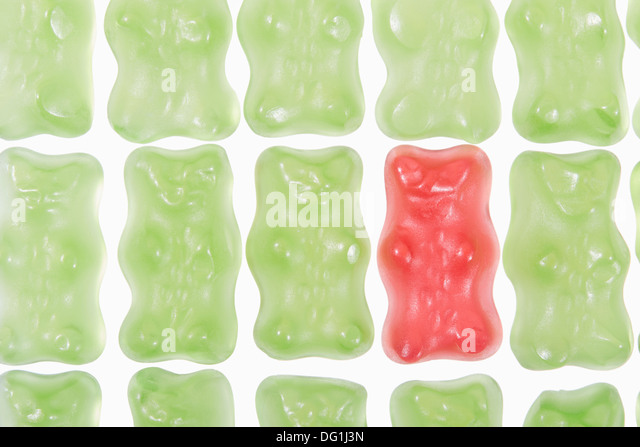 Gummy bears individuality, difference concept isolated on white - Stock Image
