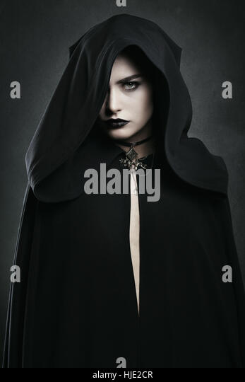 Beautiful vampire woman with black cloak . Halloween and horror - Stock-Bilder