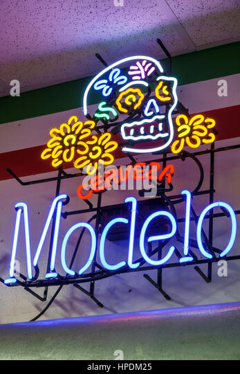 Homestead Florida Mexico Market Hispanic grocery store supermarket interior neon sign Modelo Cerveza beer Day of - Stock Image