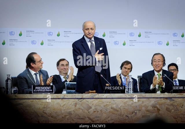 French Foreign Minister Laurent Fabius acknowledges applause after successfully steering a global agreement on greenhouse - Stock Image