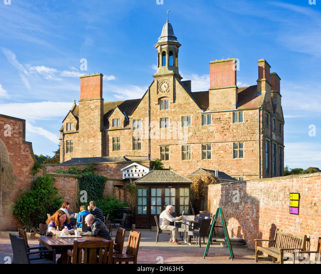 People sat at the Cafe in the courtyard at Rufford Abbey Country Park and Craft Centre Nottinghamshire England UK - Stock Image