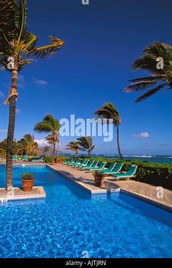 Swimming pool beside beach, Nisbet Plantation Beach Club, - Stock Image