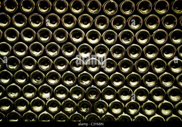 Stack of wine bottles, full frame - Stock Image