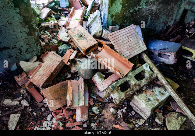 Trash and building debris at Abandoned Power Station near Jordan River, Vancouver Island, British Columbia, Canada - Stock Image