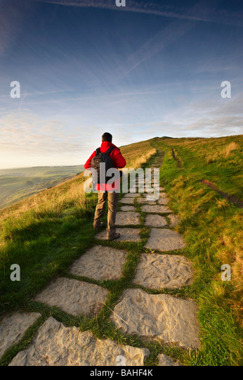 A walker at Mam Tor, Edale Valley, Peak District National Park, Derbyshire UK - Stock Image