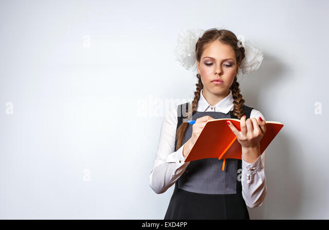 Excellent pupil writes in a notebook. The concept of modern education. Back to school. - Stock Image