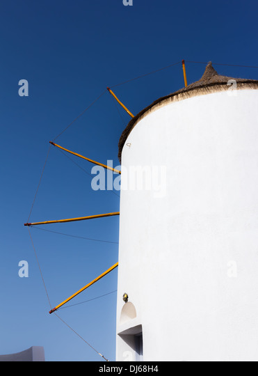 View of the Windmill and the Sea in Oia, Santorini, Greece - Stock Image
