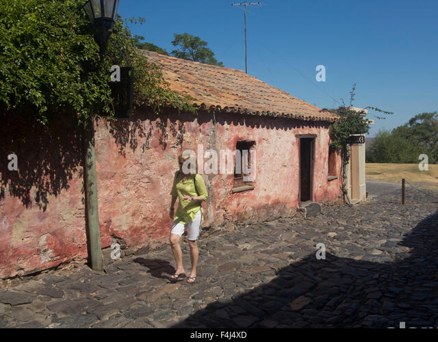 Tourists in the old colonial town of Colonia in Uruguay, South America - Stock Image