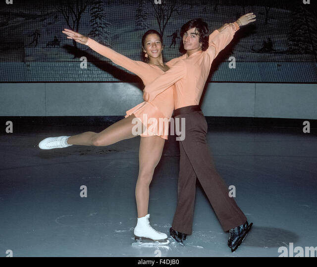 American teenagers Tai Babilonia, 18, and Randy Gardner, 19, practice their pair ice skating routines in 1977 at - Stock Image