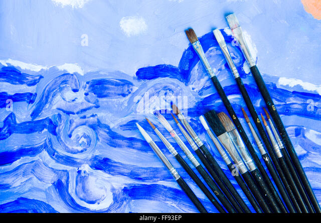 Illustrator paintbrushes on watercolor draw background - Stock Image