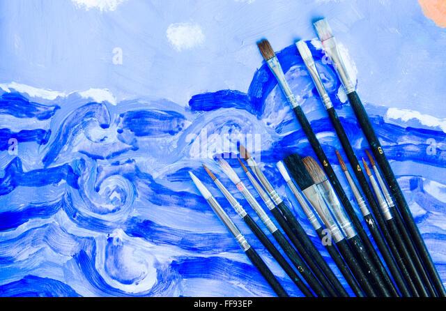 Illustrator paintbrushes on watercolor draw background - Stock Image