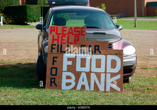 A sign that says Please help Fill Car For Food bank Foodbank - Stock Image