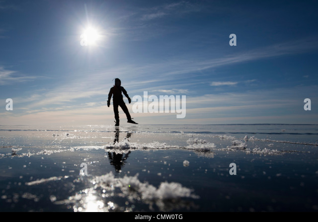 Ice skater in backlight - Stock Image