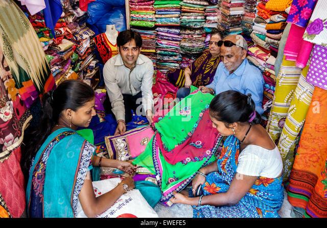 Mumbai India Indian Asian Tardeo Jehangir Boman Behram Road Krishna Collection dress store fabric sari man manager - Stock Image