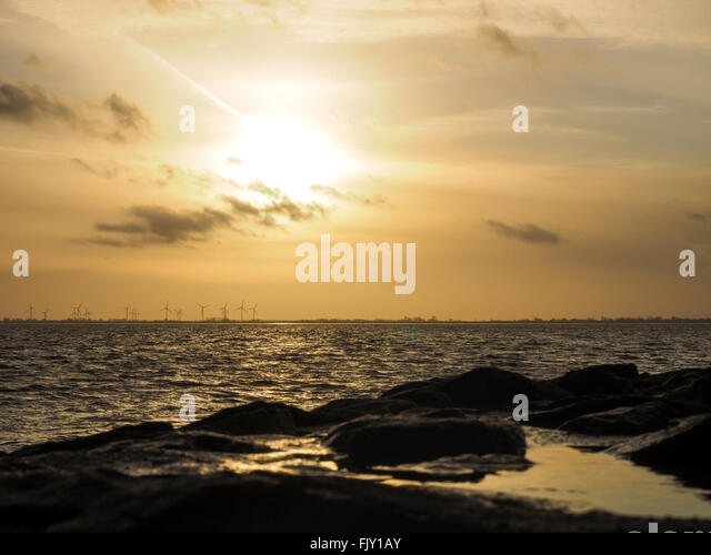 Scenic View Of Sea Against Cloudy Sky During Sunset - Stock Image