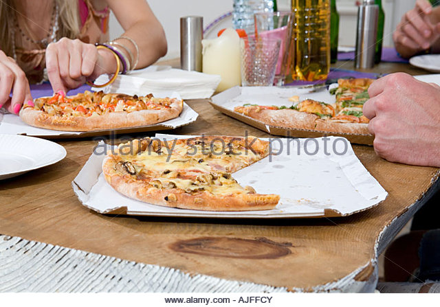 People having pizza - Stock Image