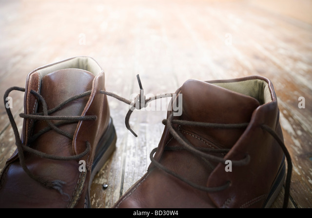 Boot laces tied together - Stock Image