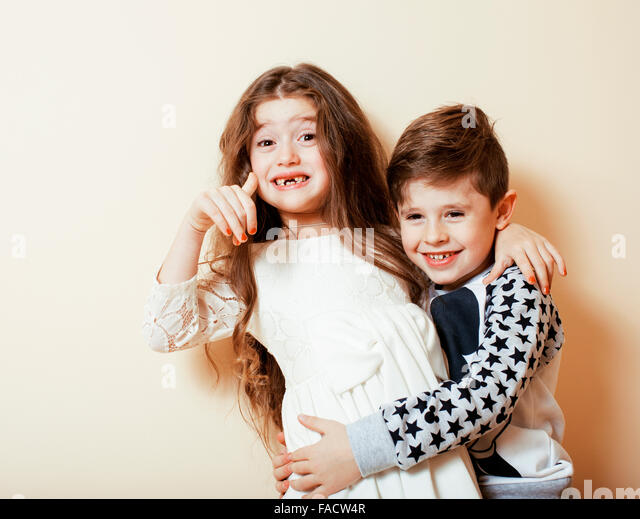 little cute boy girl hugging playing on white background, happy family close up isolated. brother and sister smiling - Stock-Bilder