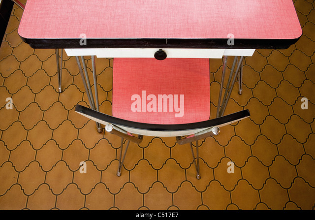 Empty chair at table, overhead view - Stock-Bilder