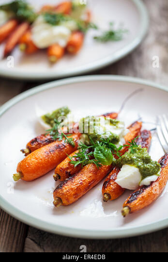 Roast carrots with mozzarella and pesto - Stock Image