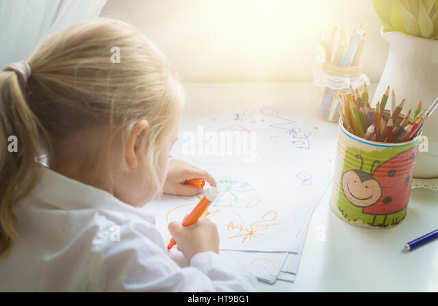 Creativity concept. Little girl drawing - Stock Image
