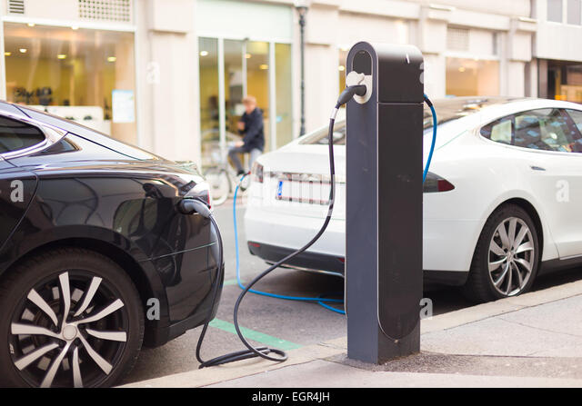Electric Cars in Charging Station. - Stock-Bilder