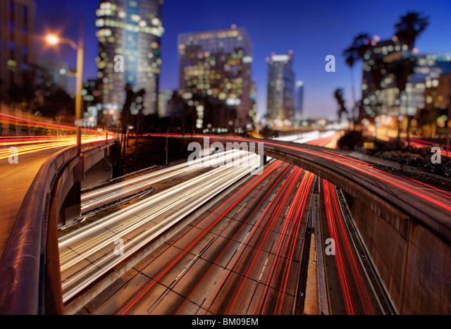 Car trails of the freeways of downtown Los Angeles at night - Stock-Bilder