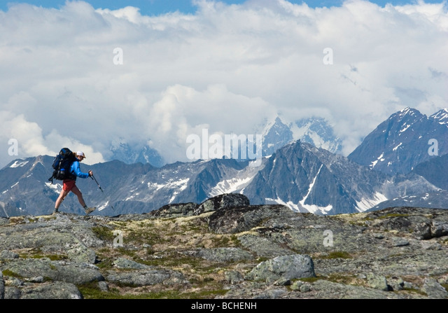 Female backpacker hikes the Kesugi Ridge trail in Denali State Park with Mt.McKinley in the background  Interior - Stock Image