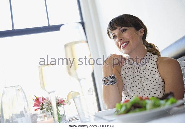 Beautiful businesswoman sitting in restaurant - Stock Image
