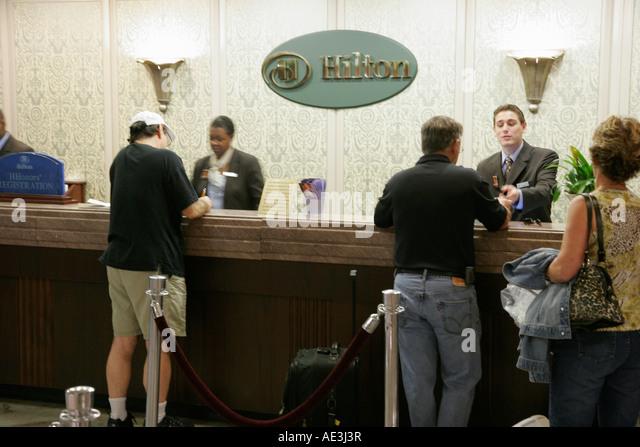 Ohio Cincinnati Hilton Netherland Plaza Hotel front desk reservationist guest services - Stock Image