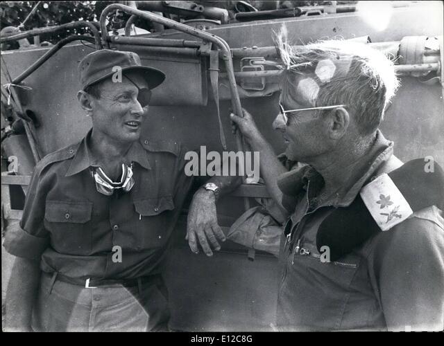 Dec. 16, 2011 - Yom Kippur War 1973 Moshe Dayan talking to an Israeli General Adnan at the Siuoi front. - Stock Image