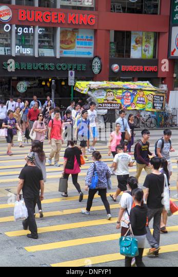 Hong Kong China Island Fortress Hill King's Road pedestrians crossing street Asian man woman Burger King fast - Stock Image