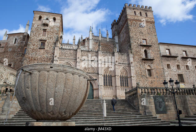 Guadalupe, Spain: february 27, 2017: Unidentified man ascending to get the Guadalupe Monastery Basilica entrance, - Stock Image