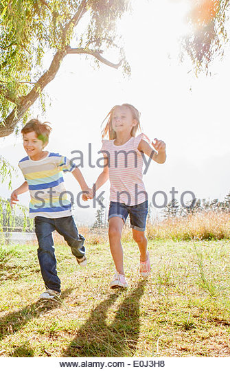 Children Having Fun In Countryside - Stock Image